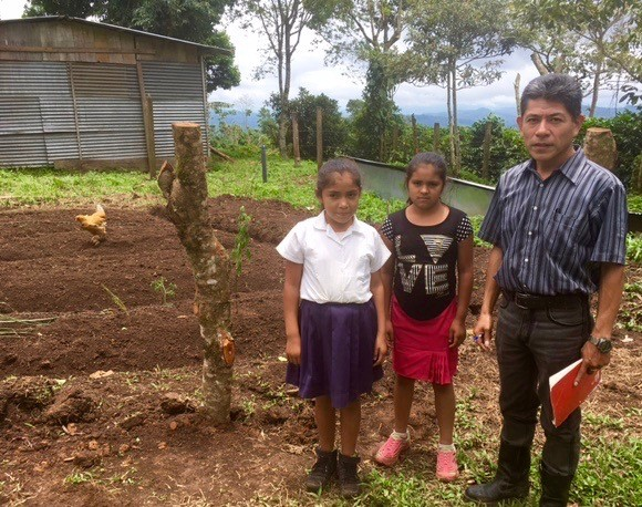 soppexcca teacher and girls in prepped garden